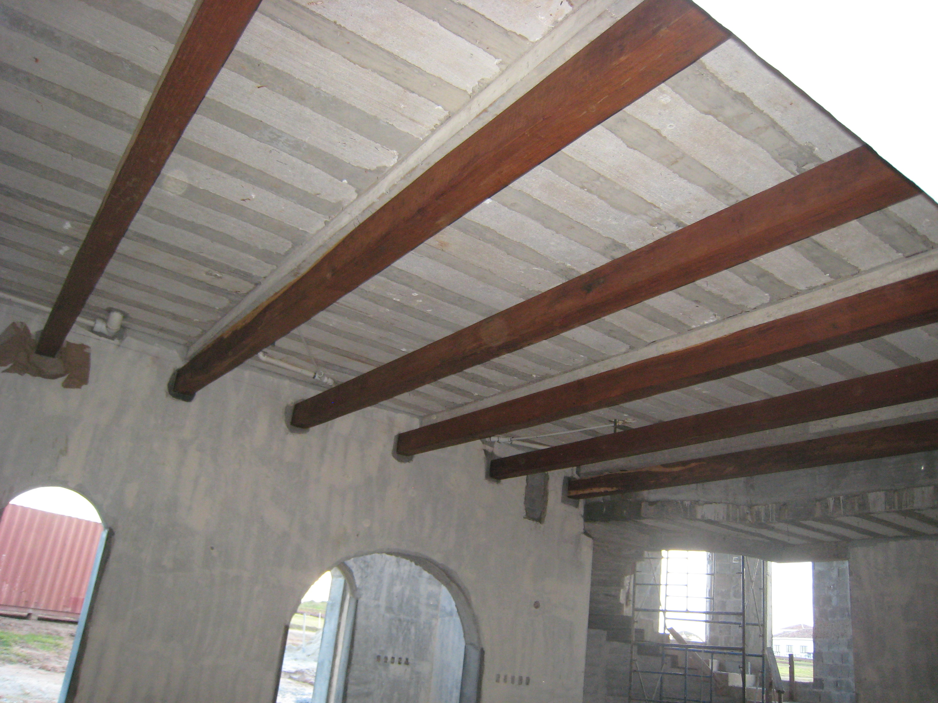The Large Wooden Ceiling Beams Have Been Installed In Livingroom And On Top Of Tower While Solid Hardwood Heavy