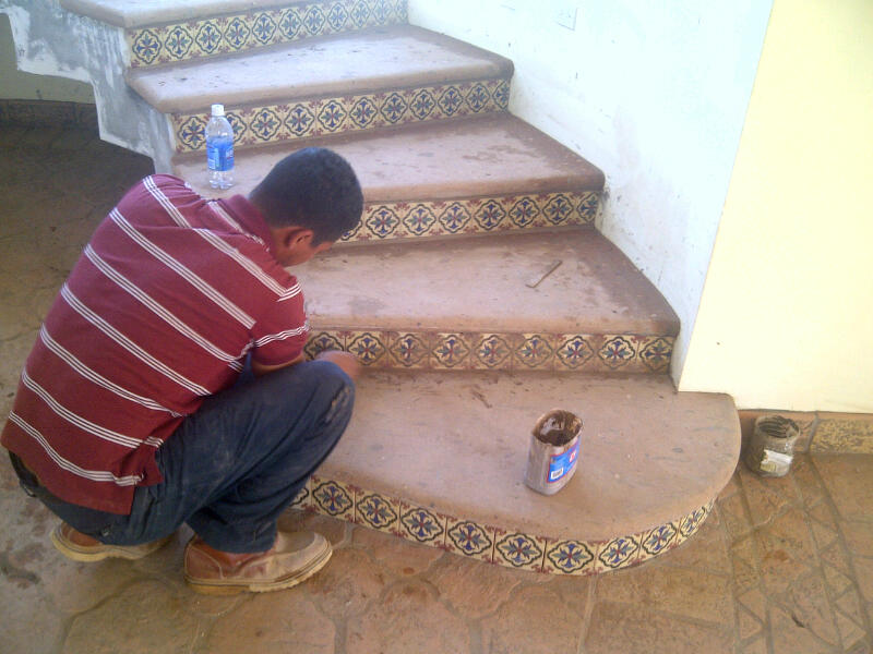 ... Is Putting Finishing Touches On The Stair Treads That He Had To Re Cut  And Also The Hand Painted Talavera Tiles He Installed On The Riser Of Each  Stair.